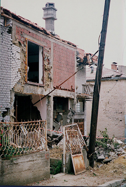 Image of a house in Pristina, Kosova a few days after the war ended, photo by author.