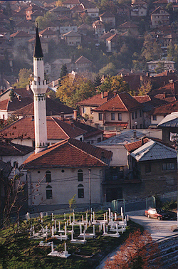 Photo of Sarajevo, with minaret and graves in foreground, photo by author.