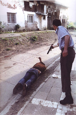 "Courtesy of the ICTY. Goran Jelisic (self-named ""the Serb Adolf"") executes a prisoner in Brcko, Bosnia-Herzegovina."