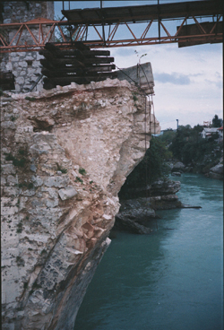 The Old Bridge (16th C) connecting Croat and Bosniak sides of Mostar, destroyed in 1993 during the war. Rebuilt and reopened 23 July 2004. Photo by author